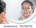 woman happy wash face with with ... | Shutterstock . vector #701785795
