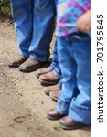 a family in cowboy boots and... | Shutterstock . vector #701795845