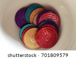 Small photo of Alcoholics anonymous chips displayed in a white bowl