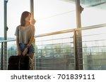 asian woman traveler with... | Shutterstock . vector #701839111