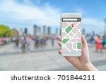 tourist using navigation app on ... | Shutterstock . vector #701844211