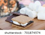 Smores Ingredients at a Beach Bonfire with Chocolate, Marshmellow, and Graham Crackers with Room for Copy - stock photo