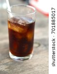 soft ice drink glass on wood... | Shutterstock . vector #701885017