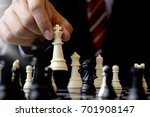 Small photo of Businessman play chess use King Chess Piece white to crash overthrow the competitor concept business strategy for win