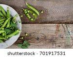 green peas on rustic wooden...   Shutterstock . vector #701917531