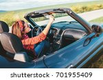 woman drives a cabriolet car | Shutterstock . vector #701955409