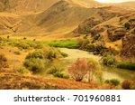 mountainous landscape and river ... | Shutterstock . vector #701960881