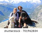 couple of hikers with dogs on... | Shutterstock . vector #701962834