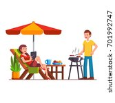 husband doing barbecue grilling ... | Shutterstock .eps vector #701992747