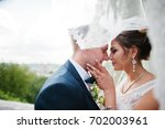 good looking newly married... | Shutterstock . vector #702003961