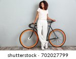 full length image of a smiling... | Shutterstock . vector #702027799