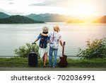 couple of traveler looking at... | Shutterstock . vector #702036991