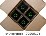 A top down view of a compartmentalized box with bottles in it. - stock photo