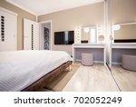 simple pastel bedroom with tv... | Shutterstock . vector #702052249