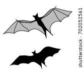 bat silhouette on white... | Shutterstock .eps vector #702052561