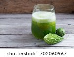 herbal juice of green momodica  ... | Shutterstock . vector #702060967