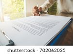 close up hand hold pen for... | Shutterstock . vector #702062035