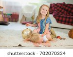 cute girl and boy play with new ... | Shutterstock . vector #702070324