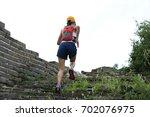 woman trail runner running at... | Shutterstock . vector #702076975