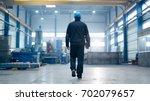Factory Worker In A Hard Hat Is ...