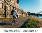 Man Riding Bicycle At...
