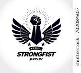 strong fist of a muscular man... | Shutterstock . vector #702084607