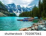 canoes at lake moraine canada | Shutterstock . vector #702087061
