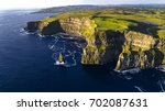 view of cliffs of moher ... | Shutterstock . vector #702087631