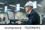 senior engineer in glasses is... | Shutterstock . vector #702098491