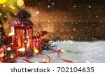 lantern with christmas... | Shutterstock . vector #702104635