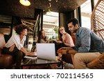 creative business team sitting... | Shutterstock . vector #702114565