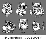 hand drawn sleepy owls  with... | Shutterstock .eps vector #702119059