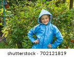 cute child standing in the park ... | Shutterstock . vector #702121819