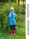 cute child standing in the park ...   Shutterstock . vector #702127075