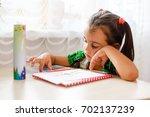 girl doing homework. the child...   Shutterstock . vector #702137239