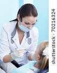The dentist examines a child in dentistry - stock photo