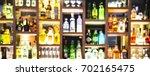 blur bottles of spirits and... | Shutterstock . vector #702165475