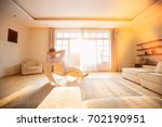 rear view of man relaxing on... | Shutterstock . vector #702190951