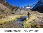 hiking scene in cordillera... | Shutterstock . vector #702194209