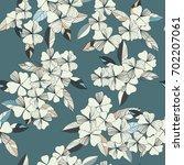 flowers seamless pattern ... | Shutterstock .eps vector #702207061