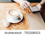 hand of woman using smartphone... | Shutterstock . vector #702208321