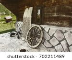 old horse car wheel and plow | Shutterstock . vector #702211489