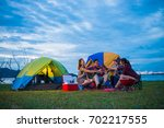 camping of happy asian young... | Shutterstock . vector #702217555