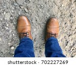 brown leather boots and blue... | Shutterstock . vector #702227269