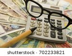 calculating numbers for income... | Shutterstock . vector #702233821
