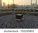 muslim pilgrims at the kaaba in ... | Shutterstock . vector #702235801