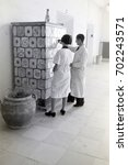 Small photo of Pottery students admiring ceramic stove