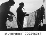Two Fishermen Repairing Fishin...