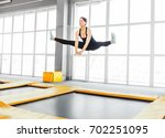 young woman amateur acrobatic... | Shutterstock . vector #702251095