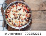 baked rice casserole with... | Shutterstock . vector #702252211